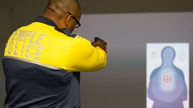 Temple Police officer Damon Mitchell tests the new Ti Training simulator. | Daniel Rainville TTN