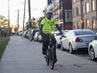 AlliedBarton Bike Officer Lamar Gargile bikes down Norris Street in his patrol zone Oct. 10. Gargile has been a bike officer for the past three years. | Jenny Kerrigan TTN