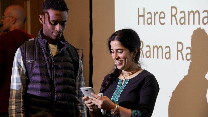 Mangal-Aarti Devi Dasi (right), one of the organizers of the Bhakti Yoga Club, talks to students about the club's programs Oct. 1.   Daniel Sebastian TTN