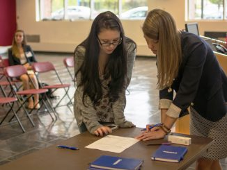 Ashley Greco (left) has her resume critiqued in an event organized by Temple SWE, Engineers without Borders and Theta Tau.   Thomas Joyce TTN