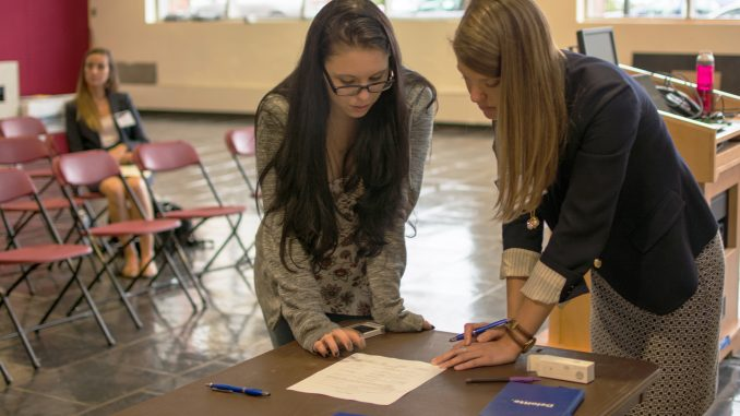 Ashley Greco (left) has her resume critiqued in an event organized by Temple SWE, Engineers without Borders and Theta Tau. | Thomas Joyce TTN