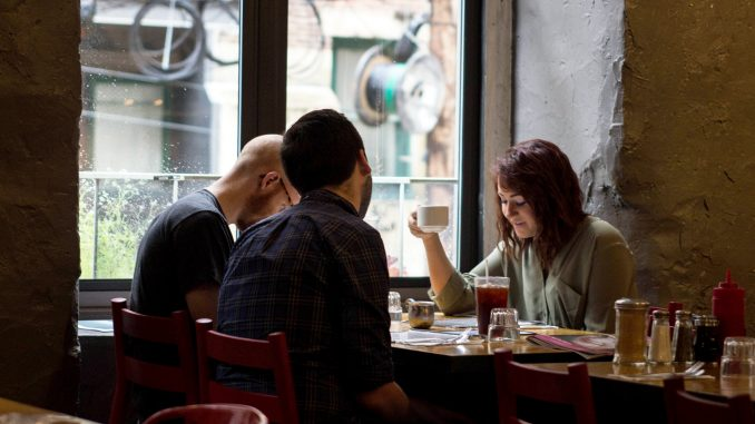 Amanda Woodward, (right), dines with friends Thomas Krauss and Sean Cassidy at Café Lift, a brunch spot in Center City that expected more customers.   Patrick Clark TTN