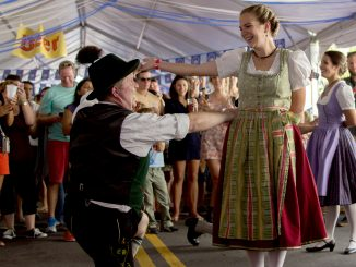 Festival-goers dressed in traditional attire to attend Frankford Hall, showcasing German dancing and music. | Patrick Clark TTN