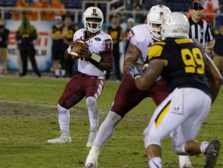 Junior quarterback P.J. Walker stands in the pocket during the fourth quarter of Temple's 32-17 loss to Toledo Tuesday night in the Marmot Boca Raton Bowl in Boca Raton, Florida.| Donald Otto