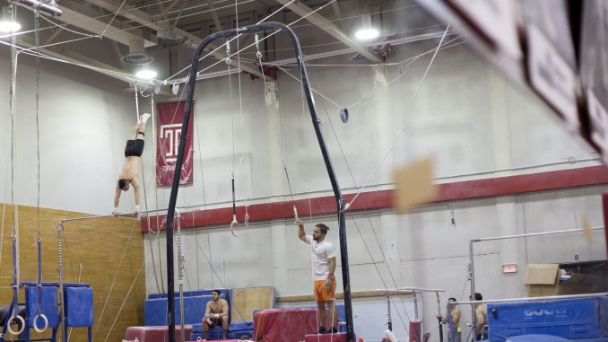 Members of the men's club gymnastics team practice Wednesday afternoon in Gymnasium 143 of McGonigle Hall. Temple Police said the gym was vandalized this past Saturday. | Jenny Kerrigan TTN