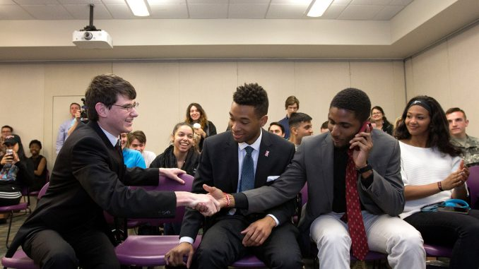 Empower TU presidential candidate Aron Cowen (left) shakes campaign manager Tykee James' hand after learning they had won the 2016-17 TSG election.   DAN RAINVILLE TTN