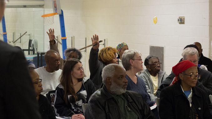North Philadelphia residents raise their hands during a vote on whether to support or oppose the building of several apartment buildings during a 32nd Democratic Ward meeting at the Amos Recreation Center March 16, 2016. | DANIEL RAINVILLE TTN