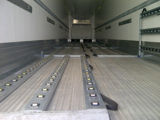 Fold-Up Roller Bed System in a Reefer Van