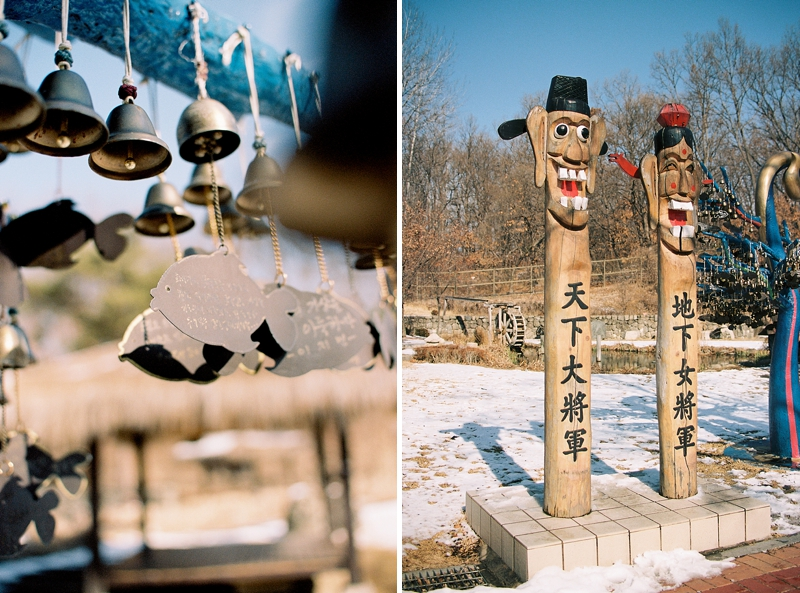 Korean fish shaped wind chime and wooden totem poles