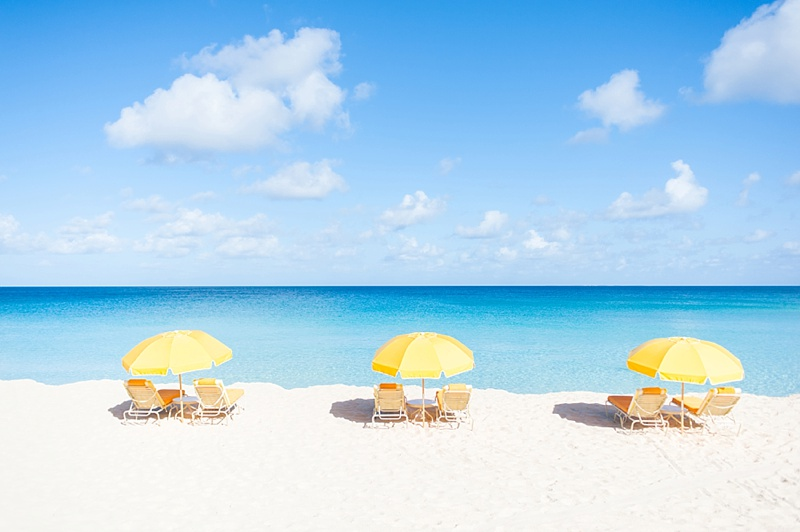 Cheerful yellow umbrellas on the white sandy beaches in Anguilla