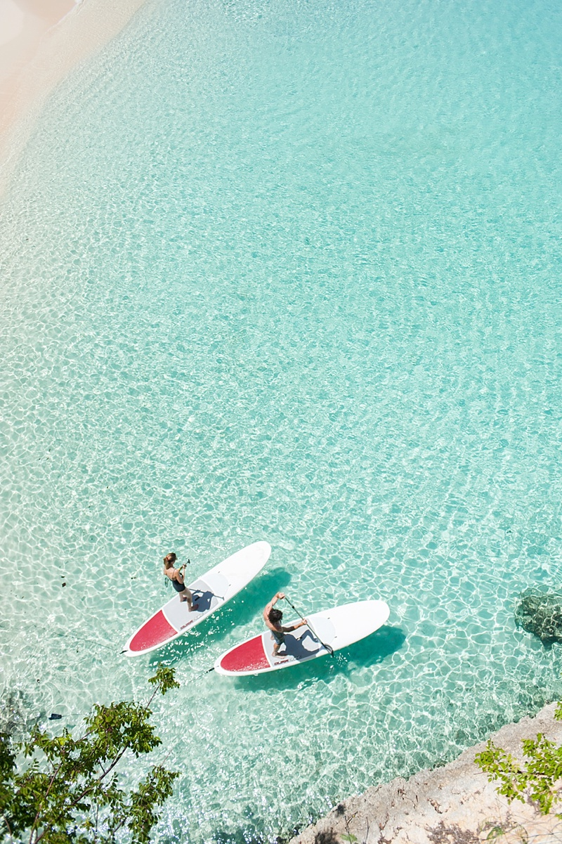 Paddleboarding in crystal turquoise waters in Meads Bay in Anguilla