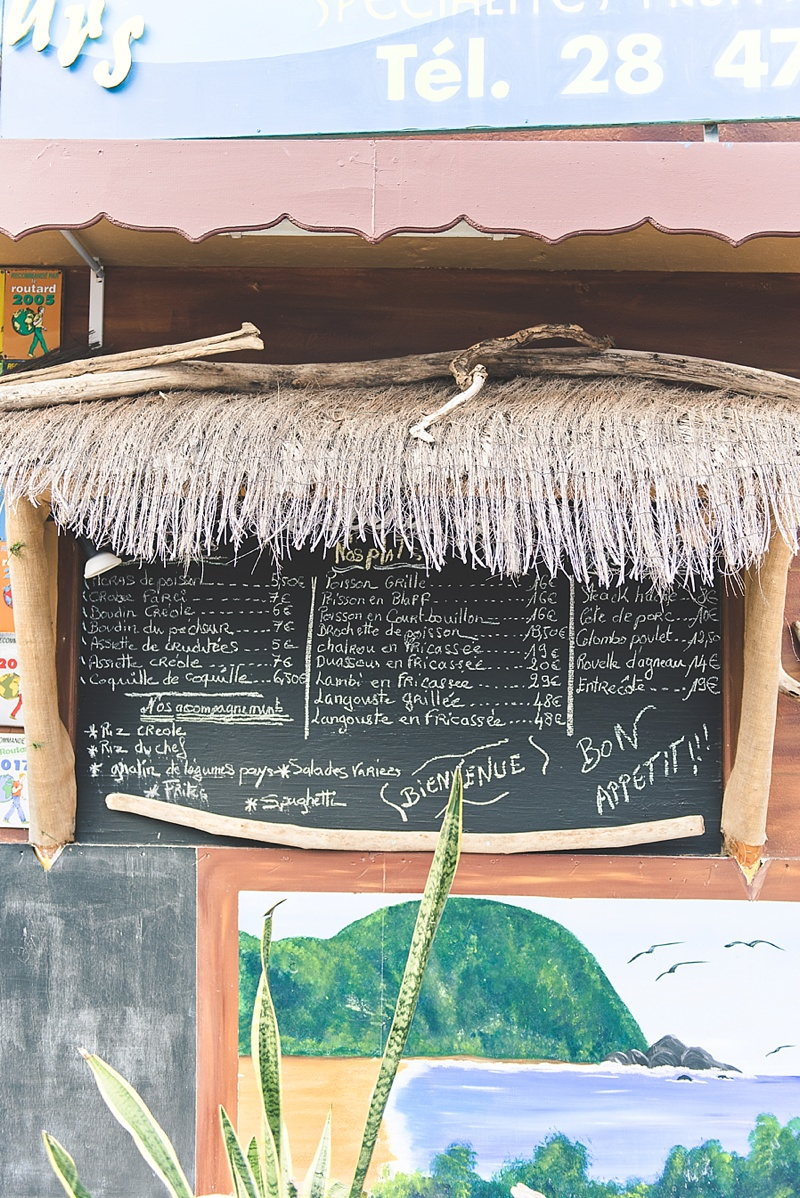 Chalkboard restaurant menu in Deshaies for a honeymoon lunch