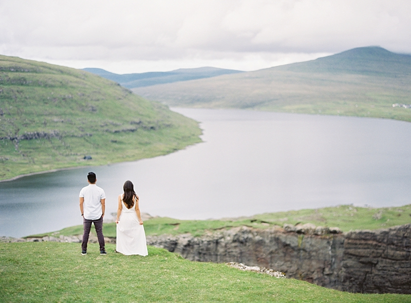 Romantic portraits overlooking cliffside in Faroe Islands