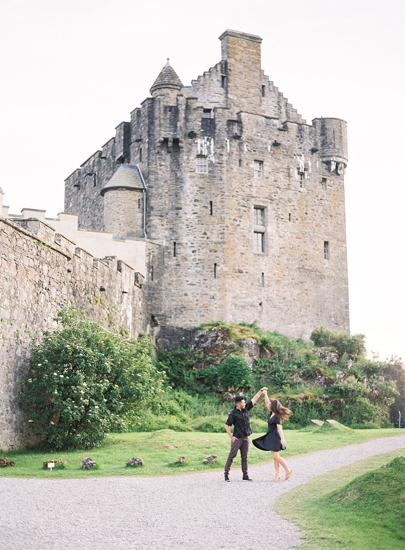 Couple celebrating their anniversary at Eilan Donan Castle in Scottish Highlands