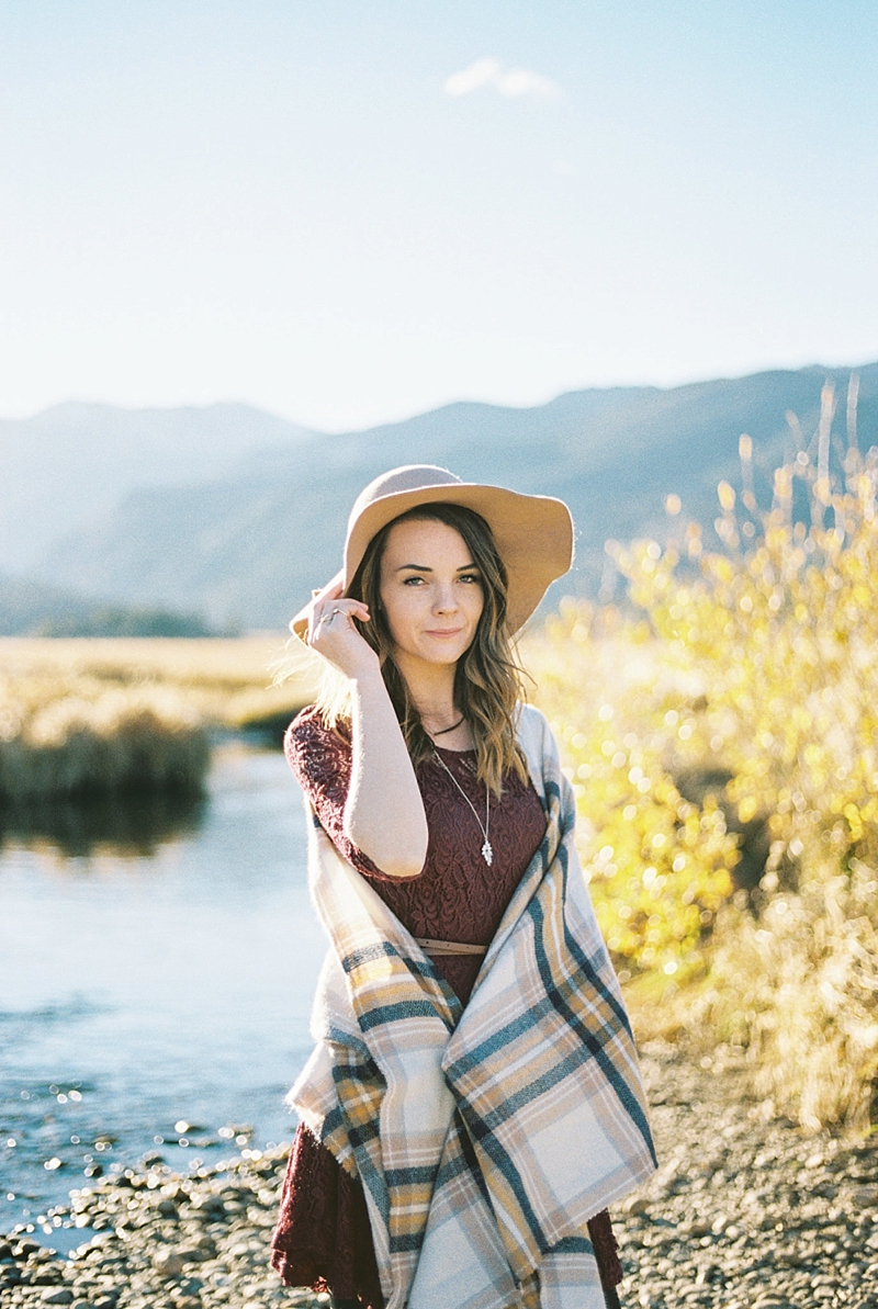 Floppy tan hat and lovely burgundy red lace dress for chic rustic vacation outfit