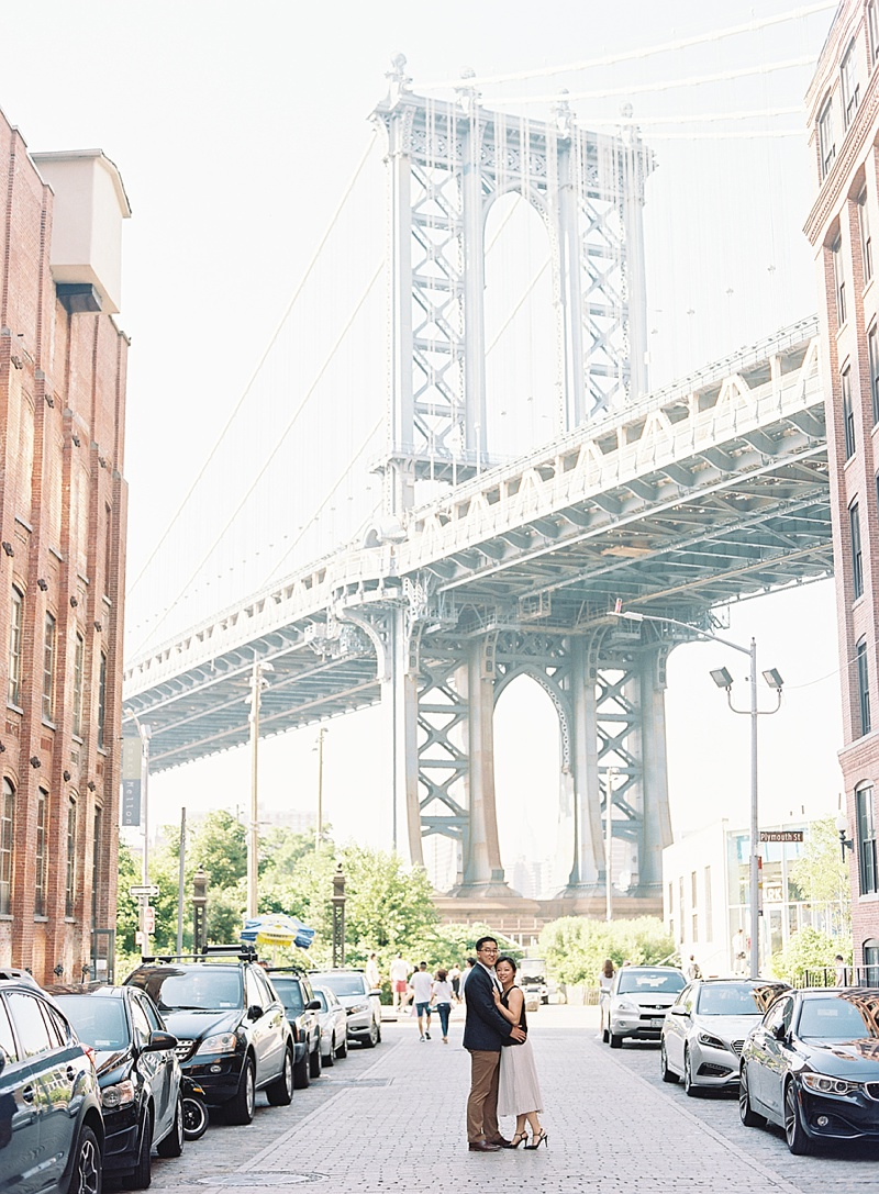 Lovely couple celebrating their marriage in front of Brooklyn Bridge