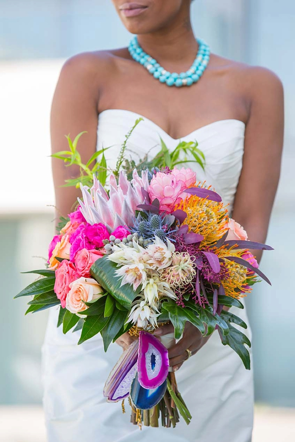 Colorful and tropical wedding bouquet with magenta pink agate stone wrap