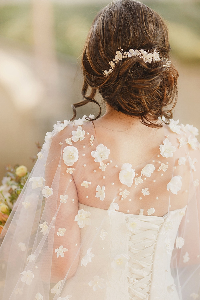 Cathedral wedding cape with fabric flowers and pearls as an elegant bridal veil alternative
