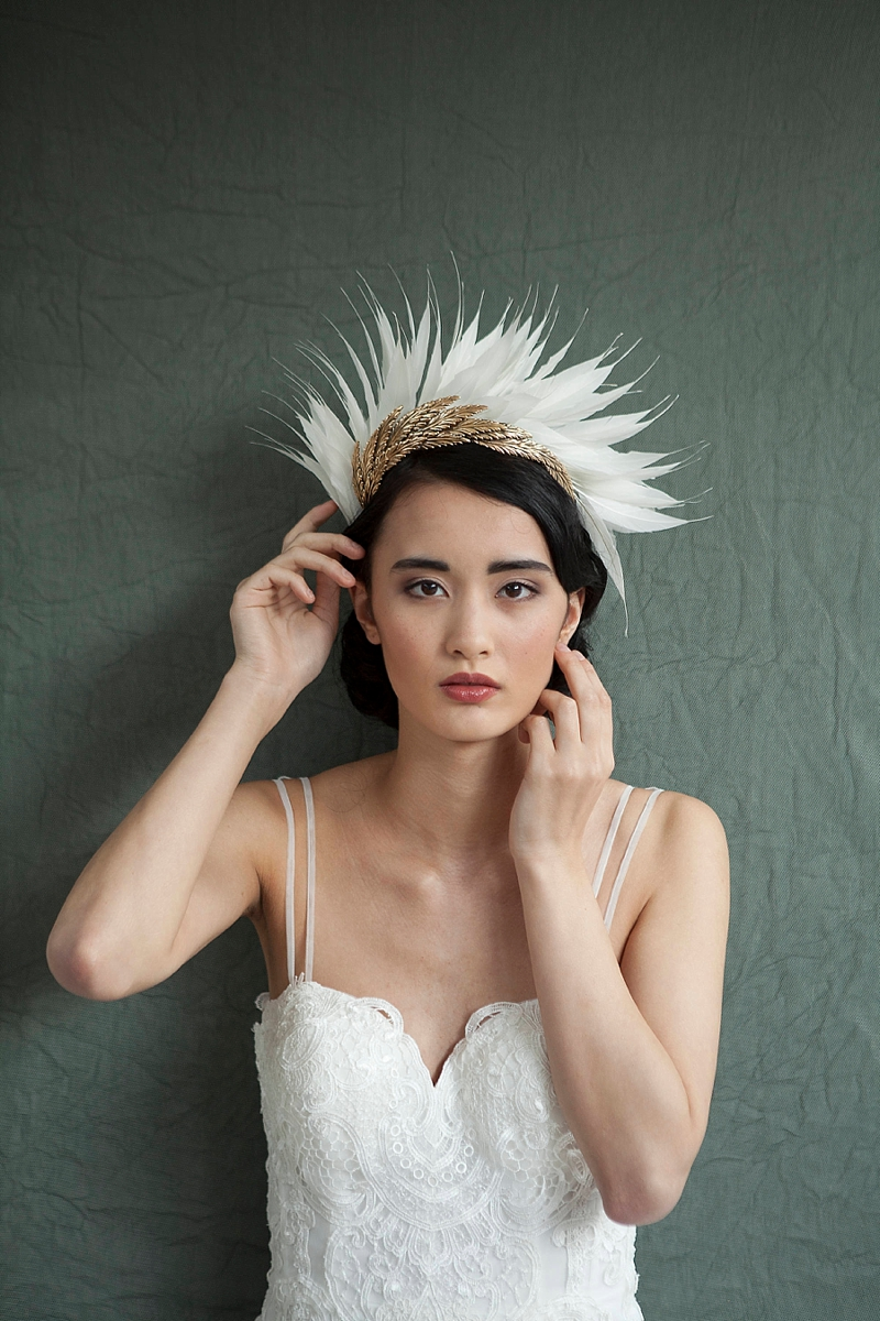 Asymmetrical modern bridal headpiece with ivory and brass feathers for showstopper alternative veil