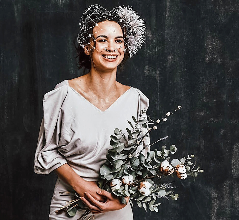 Chic modern gray birdcage veil alternative with velvet tufts and hand sculpted flowers for a stylish bride