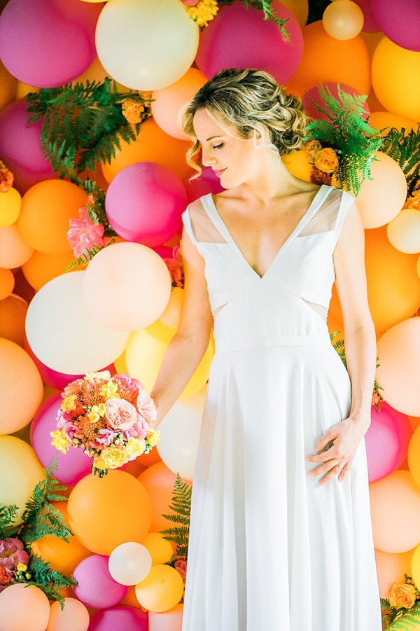 Bright and colorful wedding balloon wall for photo booth