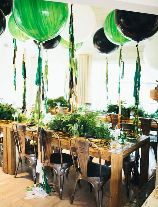 Giant green marble and black balloons for wedding decor