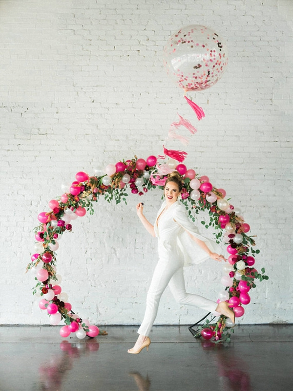 Wedding ceremony circle arch with balloons and flowers