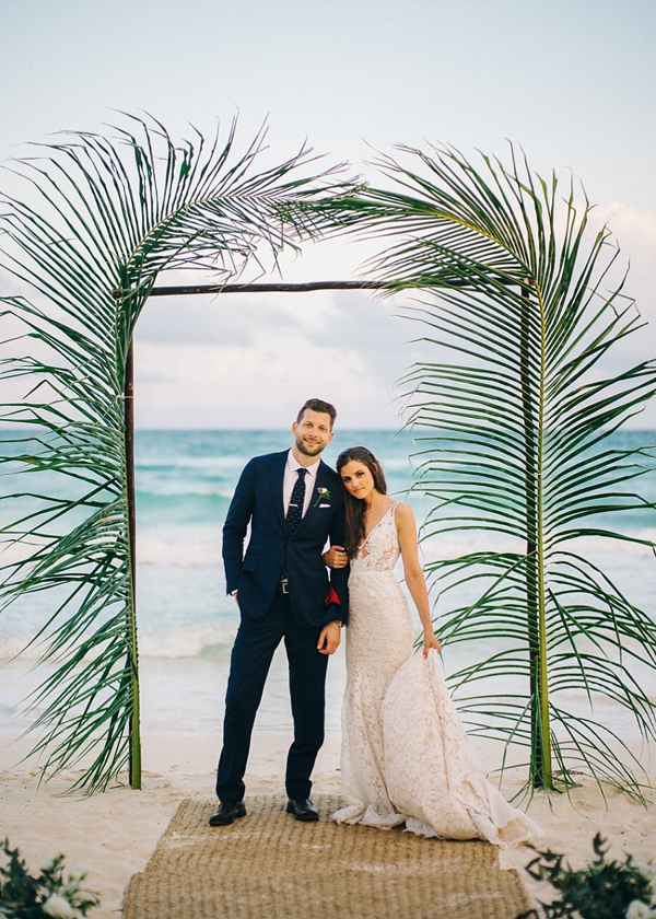 Simple modern palm leaves for beach wedding ceremony arch