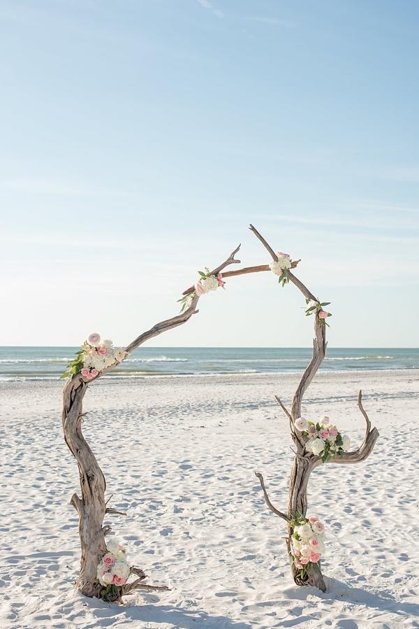 Organic beach driftwood wedding ceremony arch