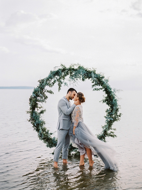 Beach wedding circle arch wreath decorated with greenery