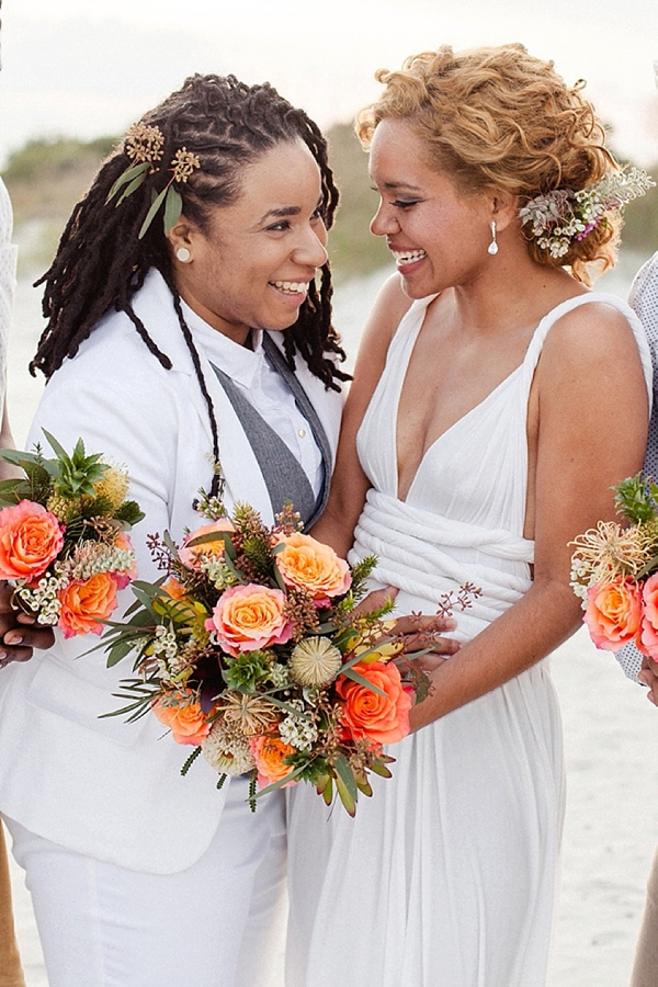 Partially pulled back locs with sprigs of seeded eucalyptus for masculine of center black bride