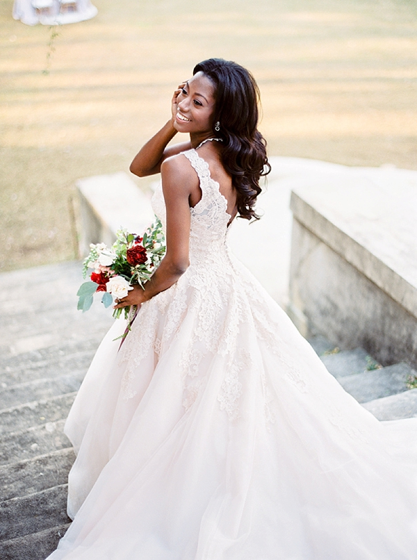 Loose and long waves for timeless black bridal hairstyle