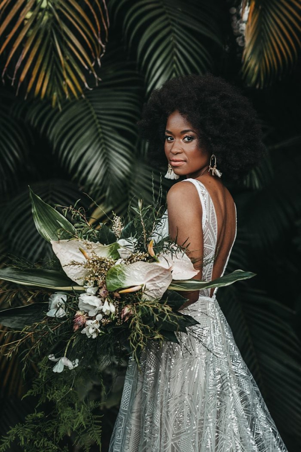 Full natural afro with statement bridal tassel earrings for modern tropical black bride
