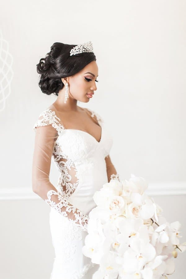 Classic updo with silver tiara for black bride