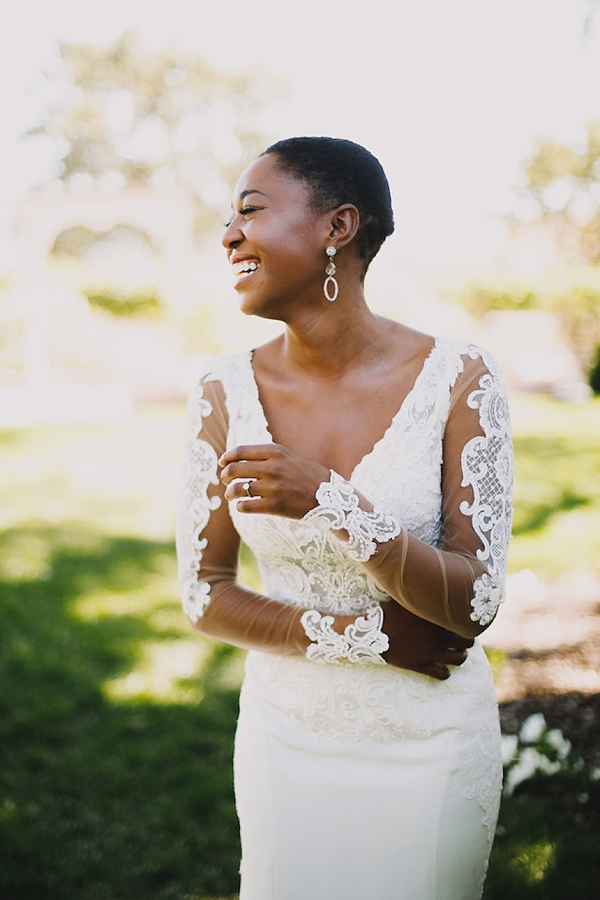 Short and bold black bride hairstyle that focuses on natural beauty