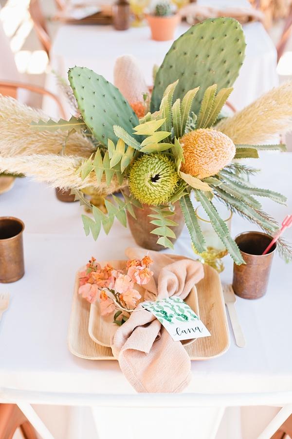 Watercolor cactus wedding place cards with pastel cactus centerpiece