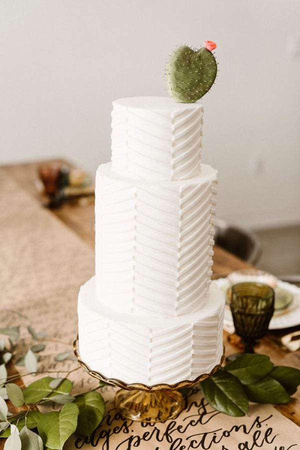 Modern rustic wedding cake with cute sugar cactus topper