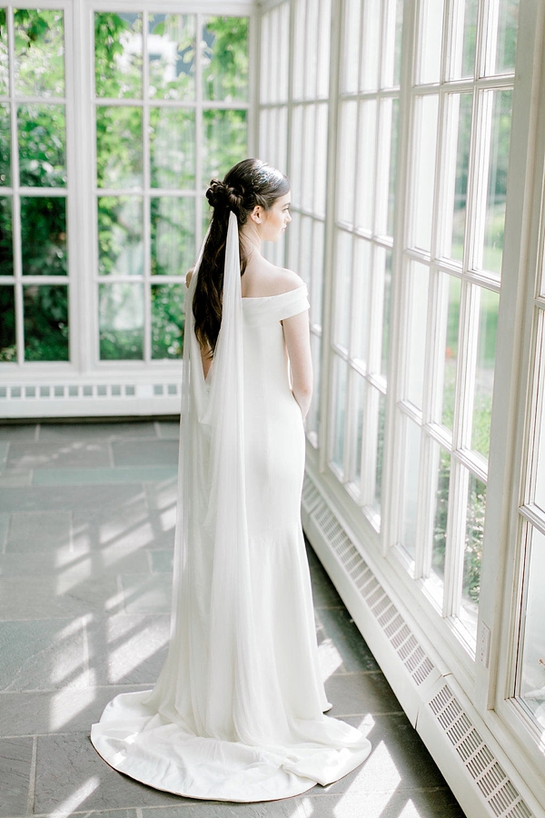 Dramatic low draped bridal veil made of silk net