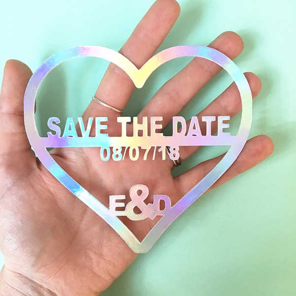 Laser cut wedding save the date made with rainbow iridescent acrylic