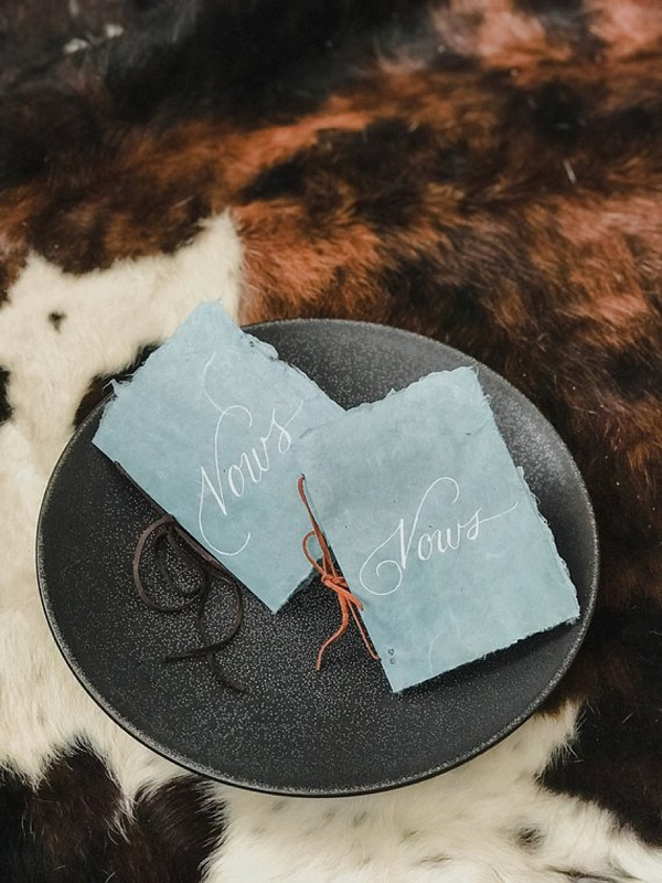 Unique chambray blue wedding vow books with leather cord detail