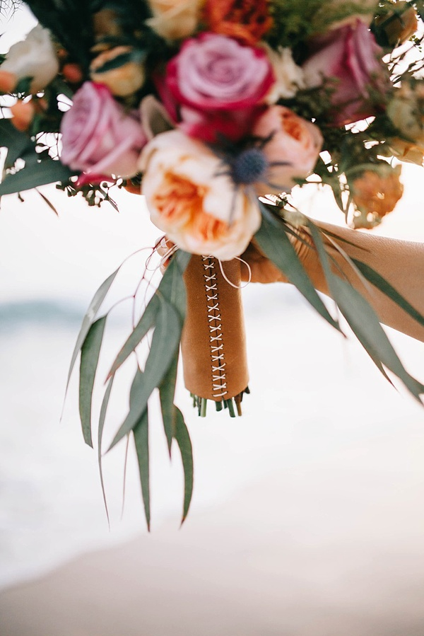 Rustic handmade leather wedding bouquet wrap