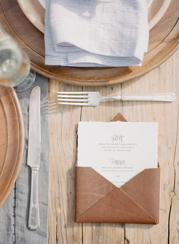 Elegant and rustic leather wedding menu sleeves