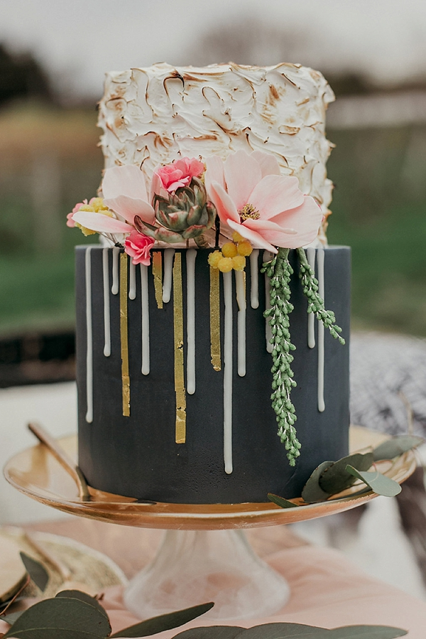 Small black wedding cake with toasted marshmallow top tier and gold details