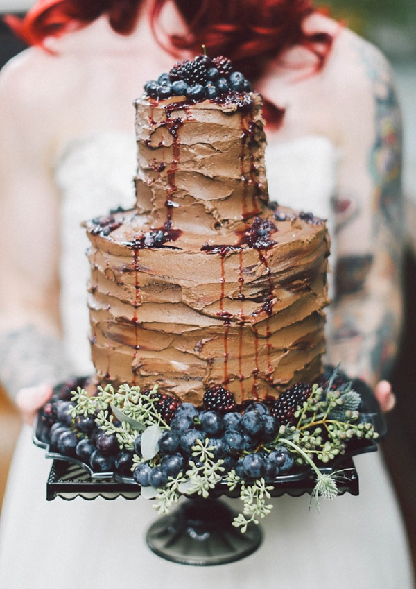 Decadent textured chocolate wedding cake dripping with berries
