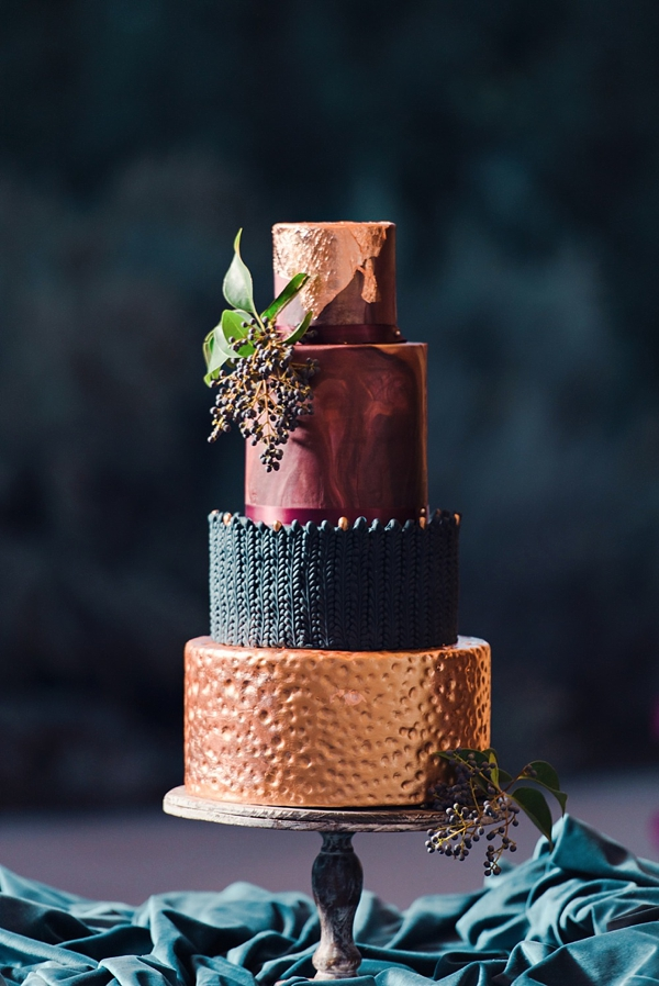 Hammered copper and cable knitted black wedding cake with marbled crimson red tier