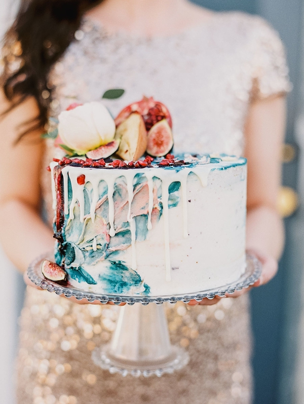 One tier spackled watercolor wedding cake with white drips and figs
