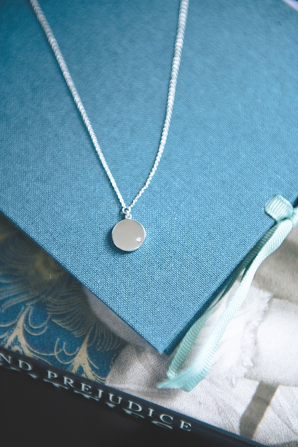 White gold disc pendant with mini diamond from Blue Nile for perfect celestial Mother of the Bride gift