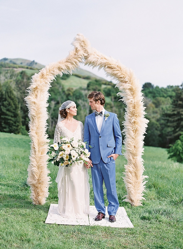 Gorgeous and lush pampas grass wedding ceremony arch