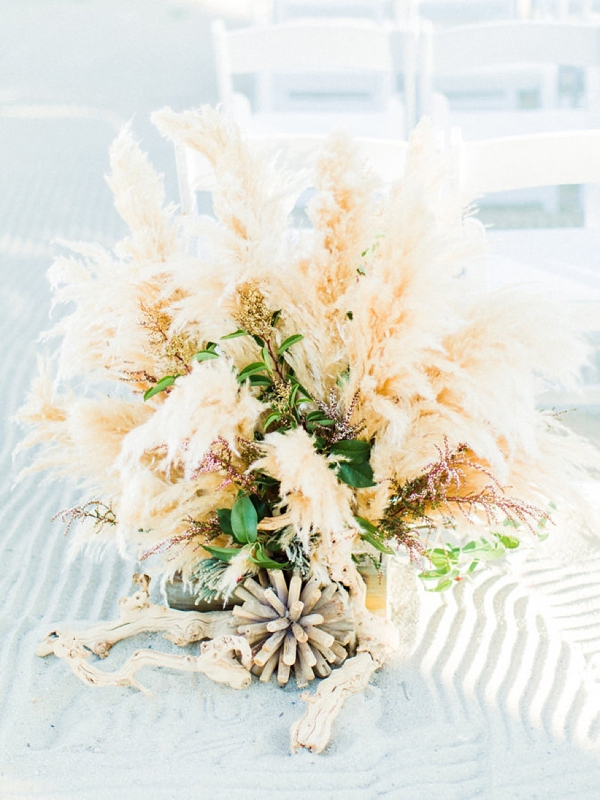 Lush ground pampas grass wedding ceremony decoration