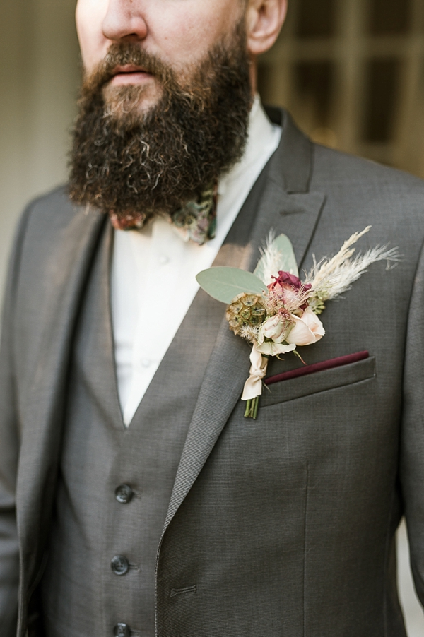 Textured groom's boutonniere with pampas grass and scabiosa pod